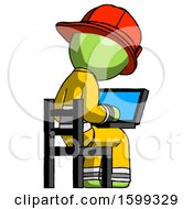 Green Firefighter Fireman Man Using Laptop Computer While Sitting In Chair View From Back