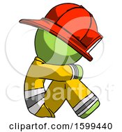 Green Firefighter Fireman Man Sitting With Head Down Facing Sideways Right