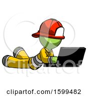 Green Firefighter Fireman Man Using Laptop Computer While Lying On Floor Side Angled View
