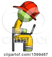 Green Firefighter Fireman Man Using Laptop Computer While Sitting In Chair View From Side