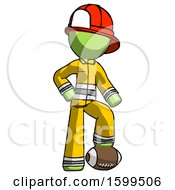 Green Firefighter Fireman Man Standing With Foot On Football