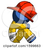 Blue Firefighter Fireman Man Sitting With Head Down Facing Sideways Right