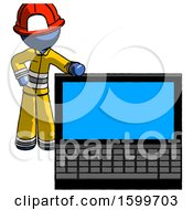 Blue Firefighter Fireman Man Beside Large Laptop Computer Leaning Against It