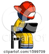 Blue Firefighter Fireman Man Using Laptop Computer While Sitting In Chair Angled Right