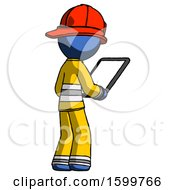 Blue Firefighter Fireman Man Looking At Tablet Device Computer Facing Away