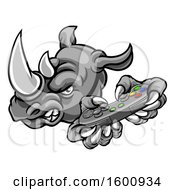 Clipart Of A Tough Rhino Monster Mascot Holding A Video Game Controller Royalty Free Vector Illustration by AtStockIllustration