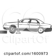 Clipart Of A Car Lifted On A Jack With A Tire Being Replaced Royalty Free Vector Illustration