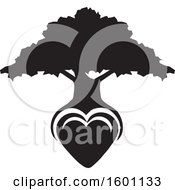 Black And White Silhouetted Tree With A Heart As The Roots