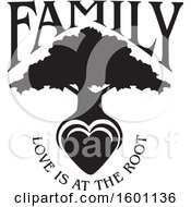 Black And White Silhouetted Tree With A Heart And Love Is At The Root Text