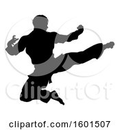 Clipart Of A Silhouetted Martial Artist Kicking Royalty Free Vector Illustration