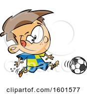 Clipart Of A Cartoon White Boy Playing Soccer Royalty Free Vector Illustration