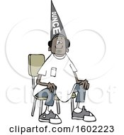 Clipart Of A Cartoon Black Boy Wearing A Dunce Hat And Sitting In A Chair Royalty Free Vector Illustration