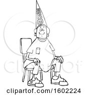 Clipart Of A Cartoon Lineart Black Boy Wearing A Dunce Hat And Sitting In A Chair Royalty Free Vector Illustration