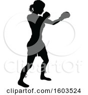 Clipart Of A Black Silhouetted Female Boxer Fighter Royalty Free Vector Illustration by AtStockIllustration