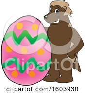 Clipart Of A Wolverine School Mascot Character With An Easter Egg Royalty Free Vector Illustration by Toons4Biz