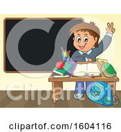 Caucasian School Boy Raising His Hand At His Desk In Front Of A Blackboard