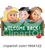 Group Of School Children Holding A Welcome Back Chalkboard