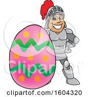 Clipart Of A Knight School Mascot Character With An Easter Egg Royalty Free Vector Illustration
