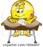 Clipart Of A Smiley Emoji School Mascot Character Writing At A Desk Royalty Free Vector Illustration by Toons4Biz