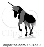 Poster, Art Print Of Black Silhouetted Unicorn Horse With A Reflection Or Shadow On A White Background