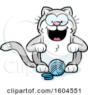 Clipart Of A Cartoon Kitty Cat With A Ball Of Yarn Royalty Free Vector Illustration