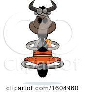 Clipart Of A Cartoon Meditating Zen Wildebeest Royalty Free Vector Illustration
