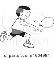 Boy Throwing A Water Balloon On Field Day