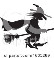 Clipart Of A Silhouetted Black Andwhite Halloween Witch Flying Royalty Free Vector Illustration