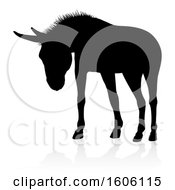 Black Silhouetted Donkey With A Shadow Or Reflection On A White Background