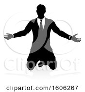 Silhouetted Business Man Kneeling With A Reflection Or Shadow On A White Background