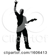 Clipart Of A Silhouetted Male Guitarist Royalty Free Vector Illustration by AtStockIllustration