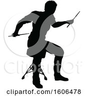 Silhouetted Male Drummer