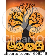 Group Of Halloween Jackolantern Pumpkins Under A Bare Tree On Orange