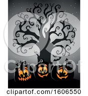 Group Of Silhouetted Halloween Jackolantern Pumpkins Under A Bare Tree On Gray