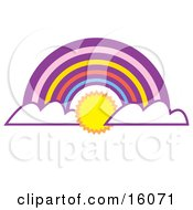 The Sun Shining Between Clouds At The End Of A Colorful Rainbow Clipart Illustration