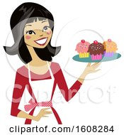 Happy Asian Baker Woman Holding A Tray Of Cupcakes