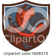 Clipart Of A Retro Woodcut Bear Mechanic Holding A Socket Wrench And Tire In A Shield Royalty Free Vector Illustration
