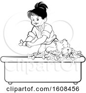 Black And White Girl Bathing A Puppy Dog In A Bath Tub