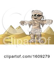 Clipart Of A Mummy And Pyramids Royalty Free Vector Illustration