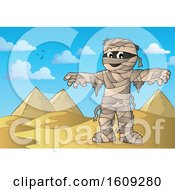 Clipart Of A Mummy And Egyptian Pyramids Royalty Free Vector Illustration by visekart