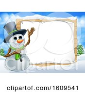 Christmas Snowman By A Blank Sign In A Winter Landscape