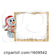 Christmas Snowman Wearing A Scarf And A Santa Hat By A Sign