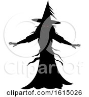 Halloween Black Silhouette Of A Scary Witch With Red Evil Eyes