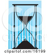 Silhouetted Sandglass Timer Dripping Sand Into The Lower Compartment Symbolizing Running Out Of Time