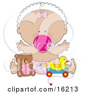Happy Baby Girl In A White Bonnet Checkered Bow And Diaper Sucking On A Pink Pacifier And Holding Her Arms Out While Playing With Toys In A Nursery