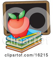 Perfect Red Apple Sitting On Top Of A Stack Of School Books Near A Pencil And Chalkboard On A Teachers Desk Clipart Illustration Image