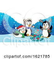 Group Of Christmas Penguins Around A Christmas Tree
