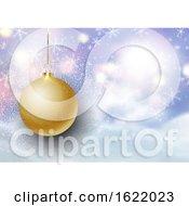 Christmas Bauble On Defocussed Snowy Landscape Background