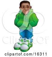 Cool African American Teenage Boy In A Green Hoodie Sweater Blue Jeans And Green And White Sneakers Standing With His Hands In The Pocket Of His Sweater