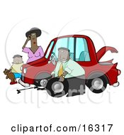 Little African American Boy Holding His Teddy Bear And Standing By A Worried Woman Sratcing Her Forehead And Watching As A Man Her Husband Or Stranger Changes The Flat Tire On Her Car